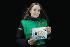 Eva Hakansson with one of the insanely powerful A123 Systems battery cells that power the KillaJoule and Green Envy.